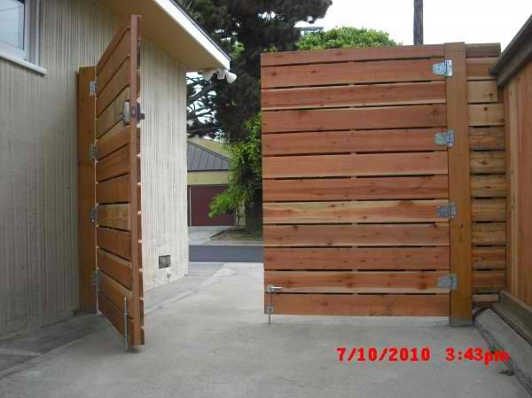 1x6 Redwood Modern Horizontal Privacy Driveway Gates With Electric Combo Deadbolt 4 Before Staining Marine Ave Manhattan Beach 90266 Wooden Gates Driveway Wood Fence Gates Backyard Gates