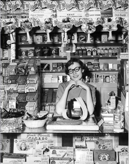 Cashier kay shallman tends the walgreens drug store at 200 north 8th street boise idaho 1954