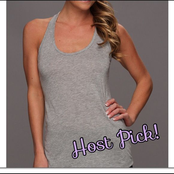 Host Pick! NWT Nike dri- fit gray flow tank  Best Dressed Host Pick 10.1.15  NWT Nike gray dri-fit flow tank. Perfect for pairing with a sports bra. Dri-fit material pulls away sweat to keep you dry and comfortable. ⛔️ NO TRADES ⛔️ Nike Tops Tank Tops #niketops