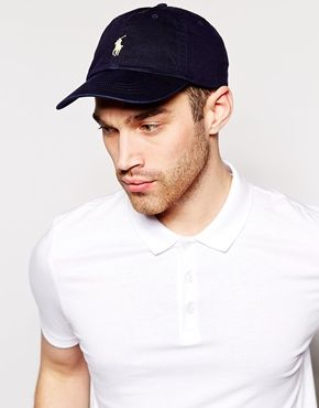 7f82c711 Shop Polo Ralph Lauren baseball cap with white player logo in washed navy  at ASOS. A Classic Polo Hat Works Well With Windbreaker