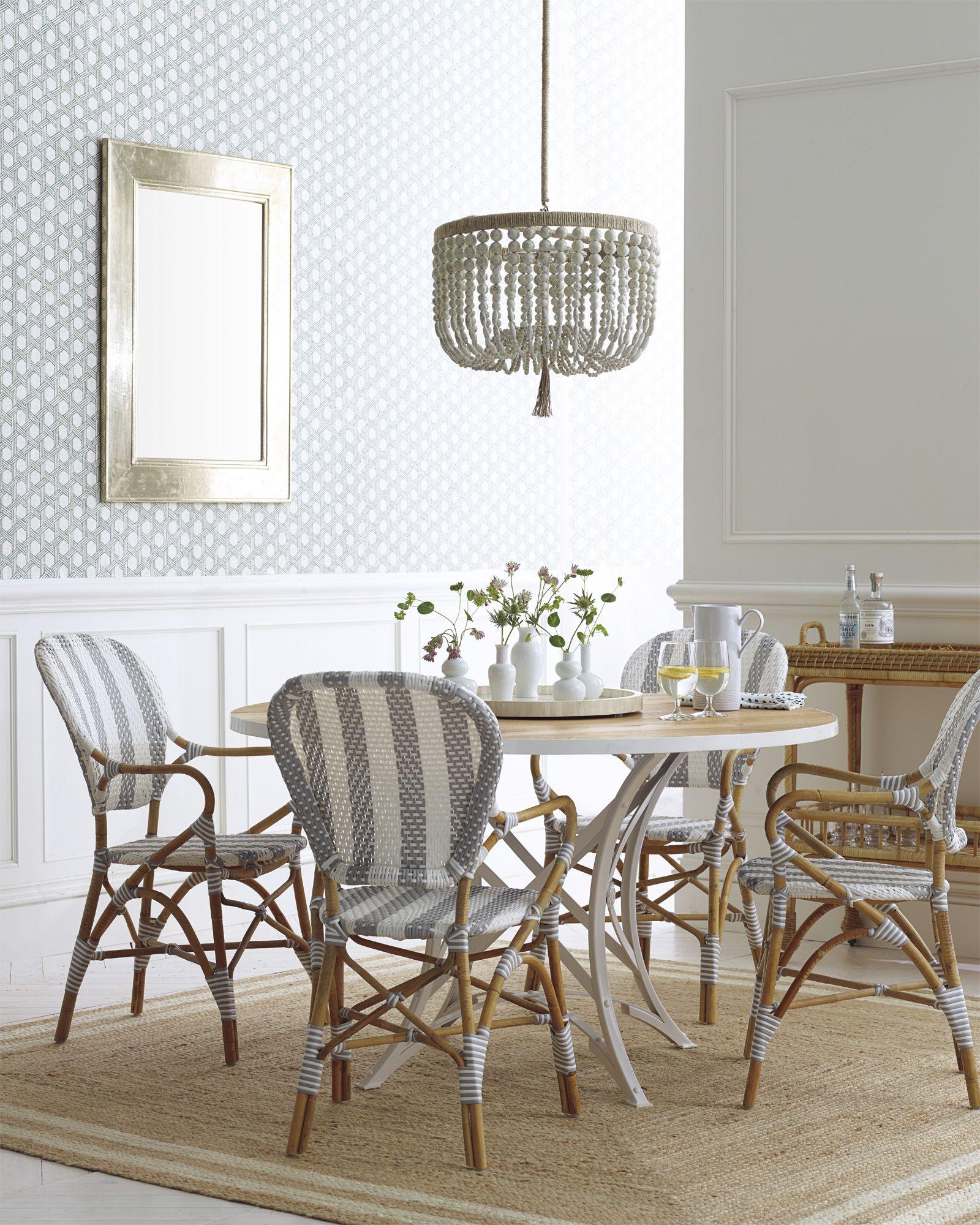 cayman cork wallpaper & riviera armchairs via serena & lily