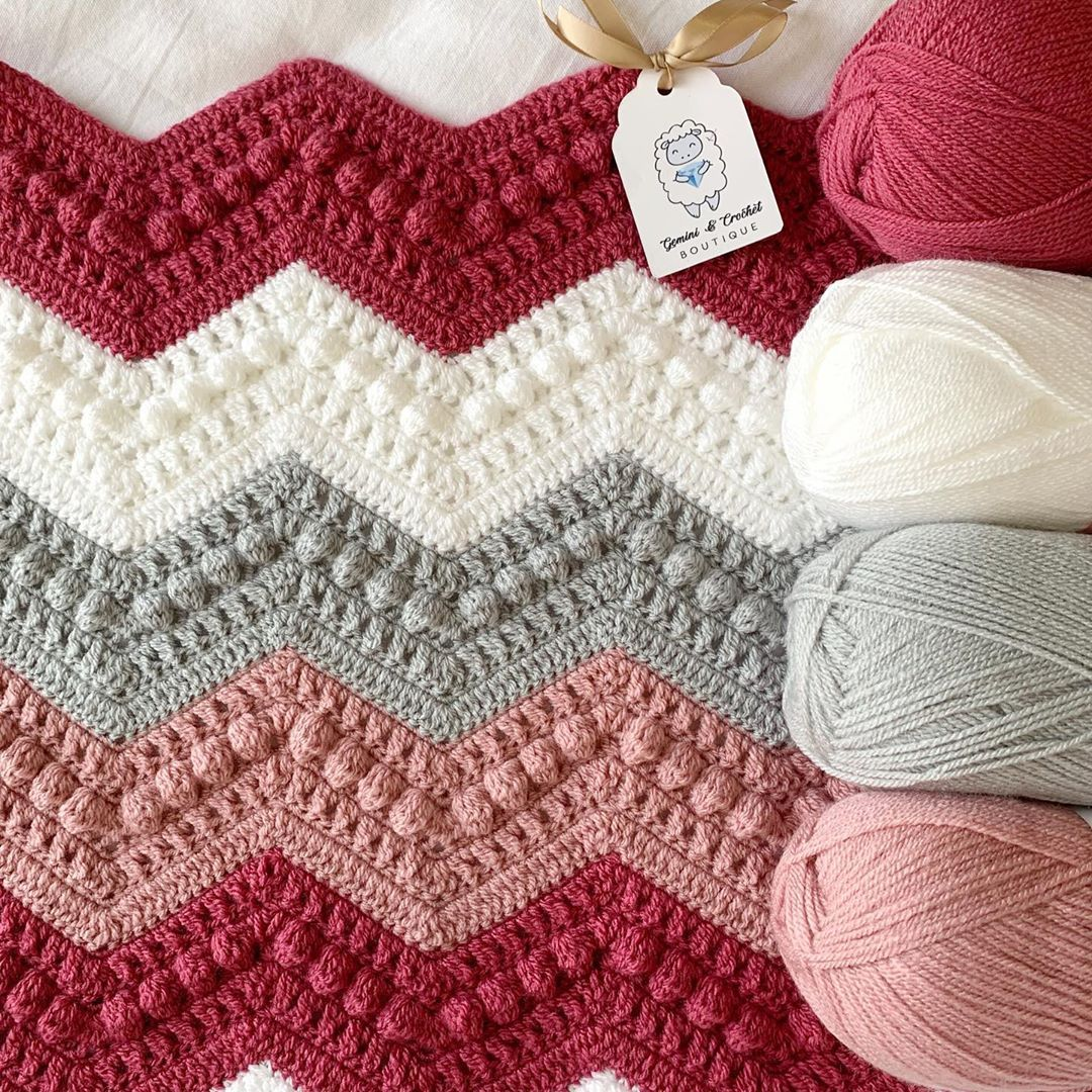 "Photo of Gemini & Crochet 💎 on Instagram: ""Hugs & Kisses blanket on the hook for one lucky baby girl 💗 pinks and greys go so well together! #crochet #lovecrochet #loveknitting…"""