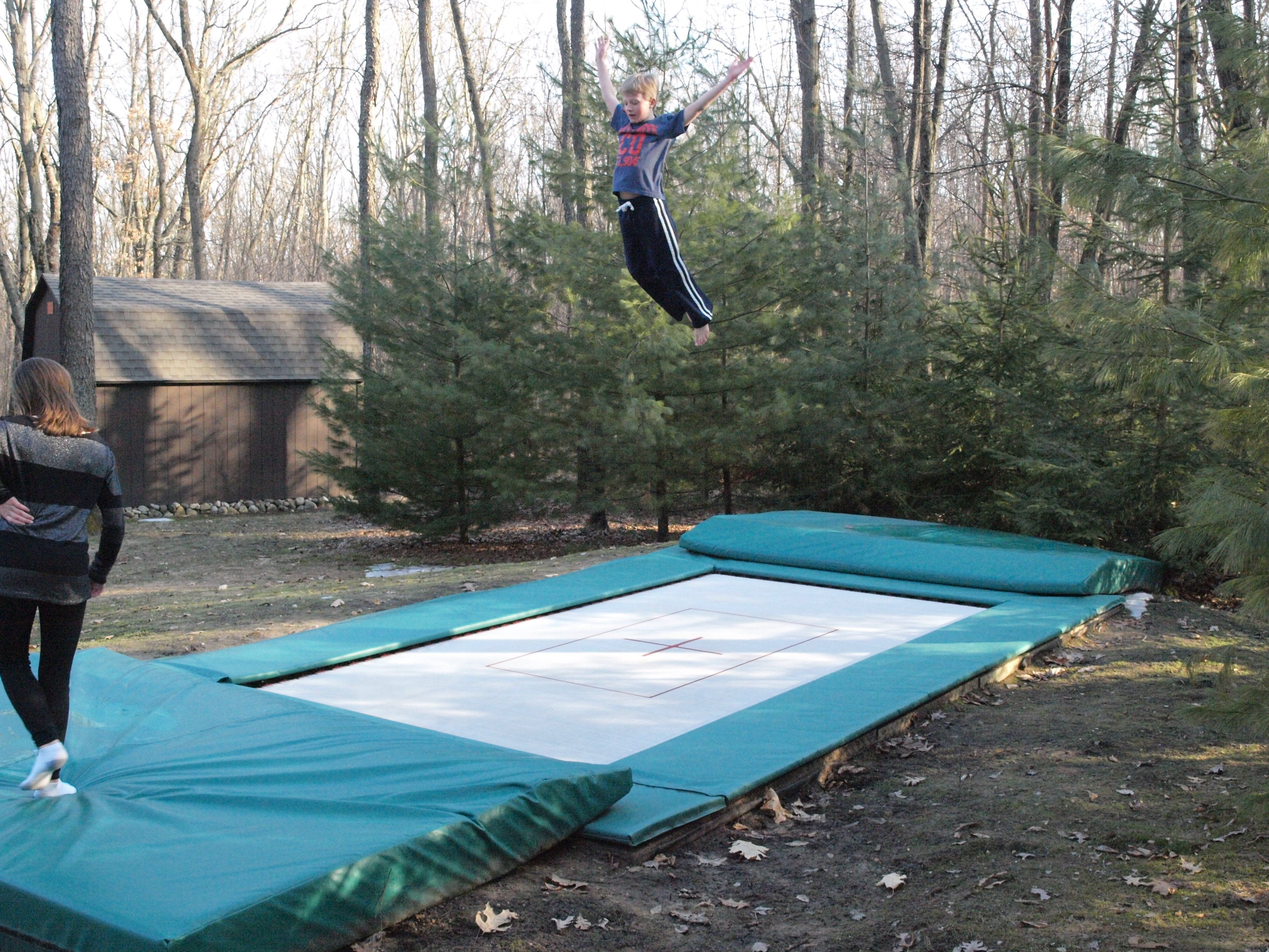 Everything You Need To Know About In Ground Trampoline Installation How Big Does The Trampoline Hole Need T In Ground Trampoline Outdoor Play Areas Trampoline