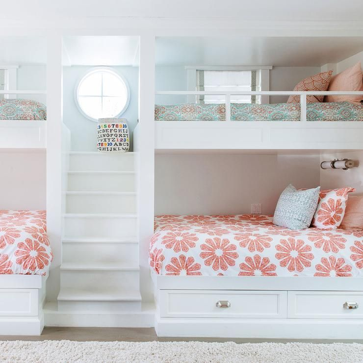 Exceptionnel Girlsu0027 Bunk Room Features A Built In Staircase Flanked By Built In Bunk Beds  Dressed In Pink And Turquoise Bedding.