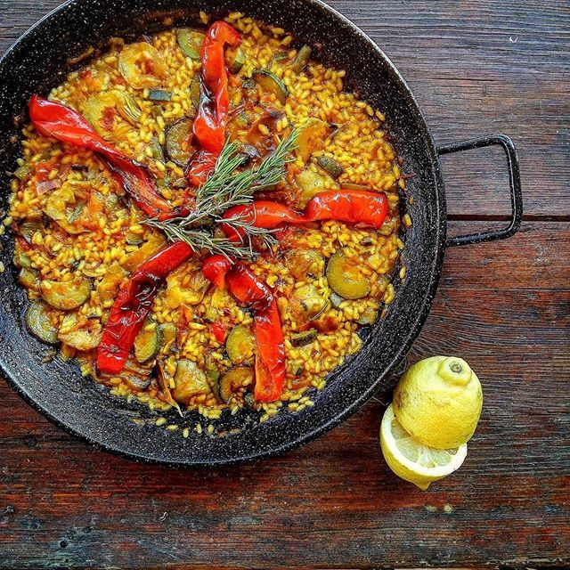 this paella de verduras with red pepper zucchini artichokes recipe is featured in the spanish food feed along with many more