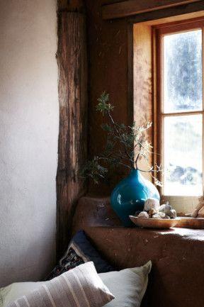Turquoise vase in the window