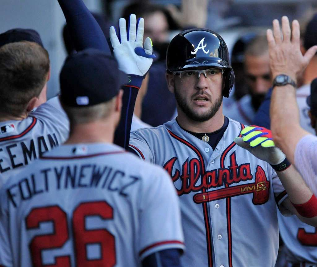 Atlanta Braves\' Tyler Flowers celebrates with teammates in the ...