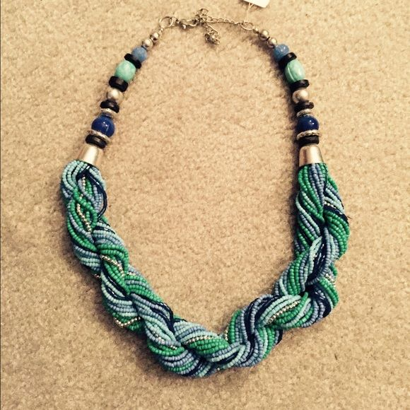 Multi strand necklace Multi strands and multi colored. The colors are navy, periwinkle, teal, greenish blue. Macy's Accessories