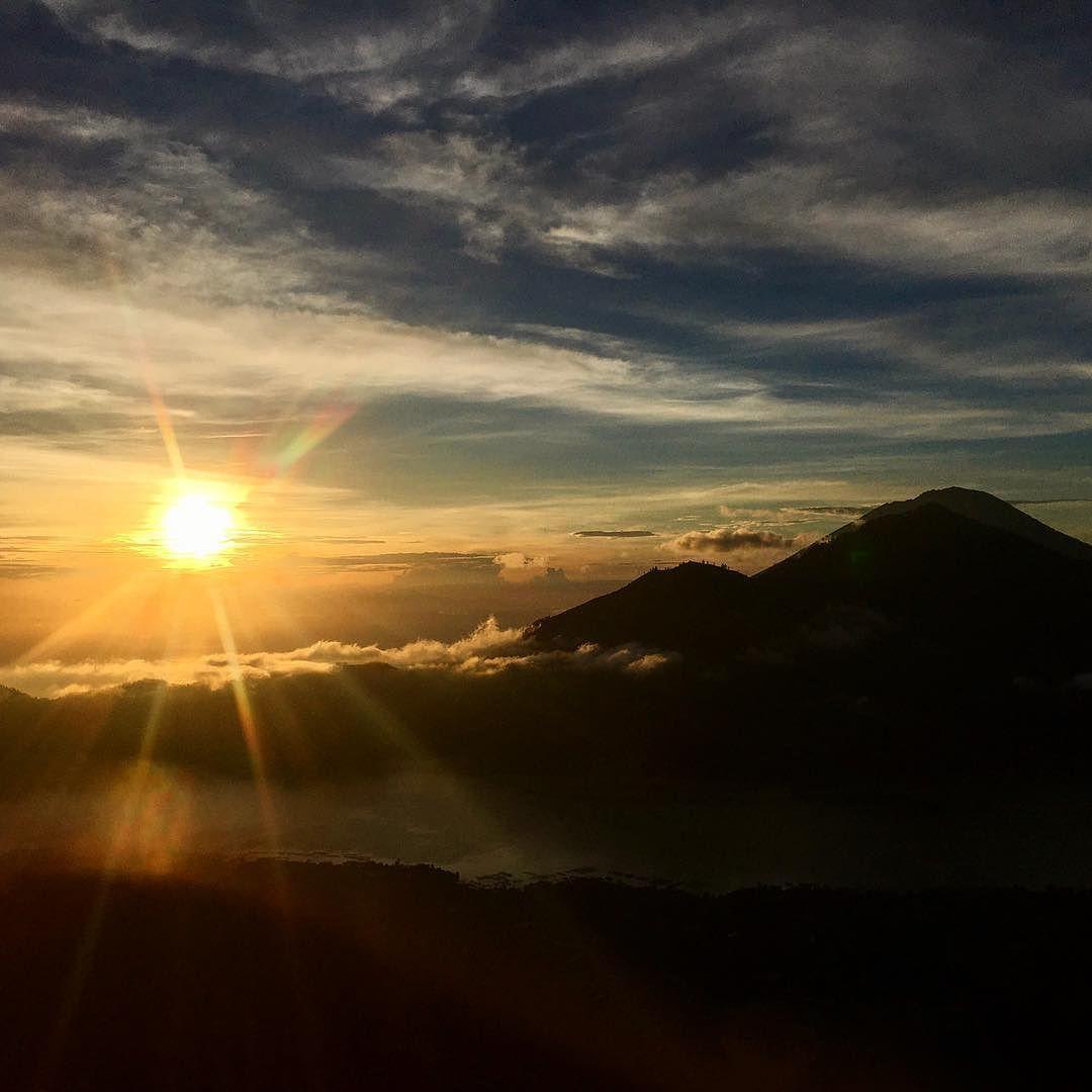 Breathtaking sunrise from the top of Mount Batur after a tiring 4am trek! #travelblogger #travel #baliisland blogger bbloggers katielewla blogginggals beautyblogger