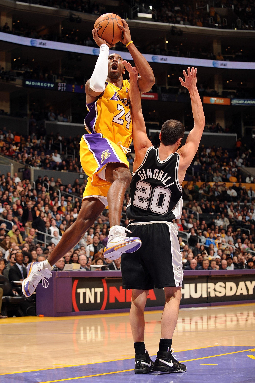 Kobe Bryant (Los Angeles Lakers) draws the contact from Manu Ginobili (San Antonio Spurs)
