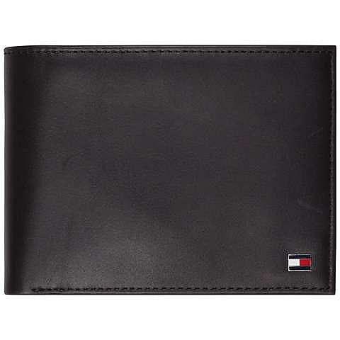 Klassische Eton Ledergeldbörse von Tommy Hilfiger mit zahlreichen Fächern und Metalllogo auf der Vorderseite.100% Leder...