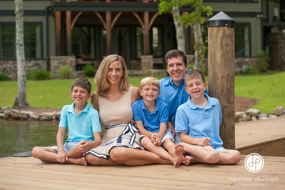 Family portraits at the lake lake martin photographer family on the dock http