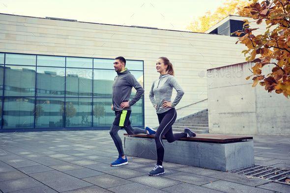 glücklicher Mann und Frau, die auf Bank im Freien von Dolgachov trainieren. Fitness, Sport, p ..., #...