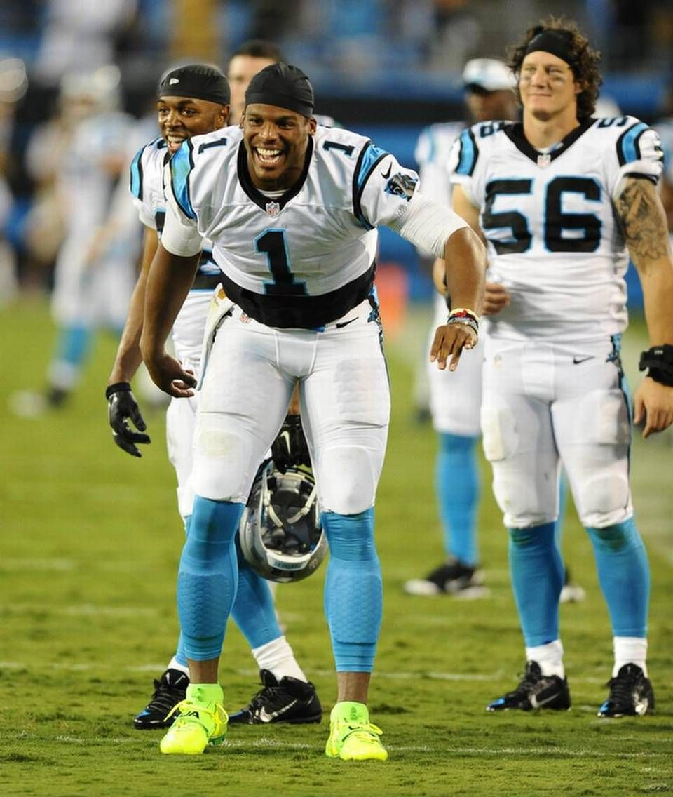 1f3be5168cf2 Carolina Panthers  Cam Newton (1) and A.J. Klein (56) react to the teams   scoring against the Miami Dolphins in the second half during their preseason  game ...