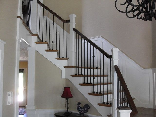 Beautiful Staircase With White Risers Black Wrought Iron