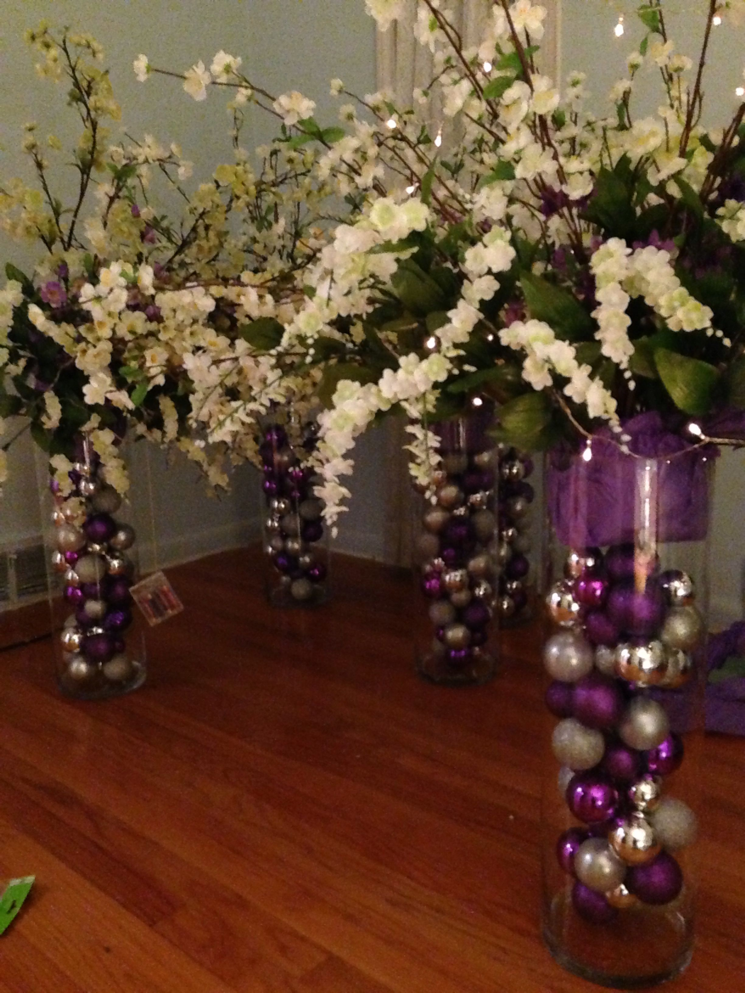 Tall Centerpieces With Purple And Silver Christmas Ornaments, White And