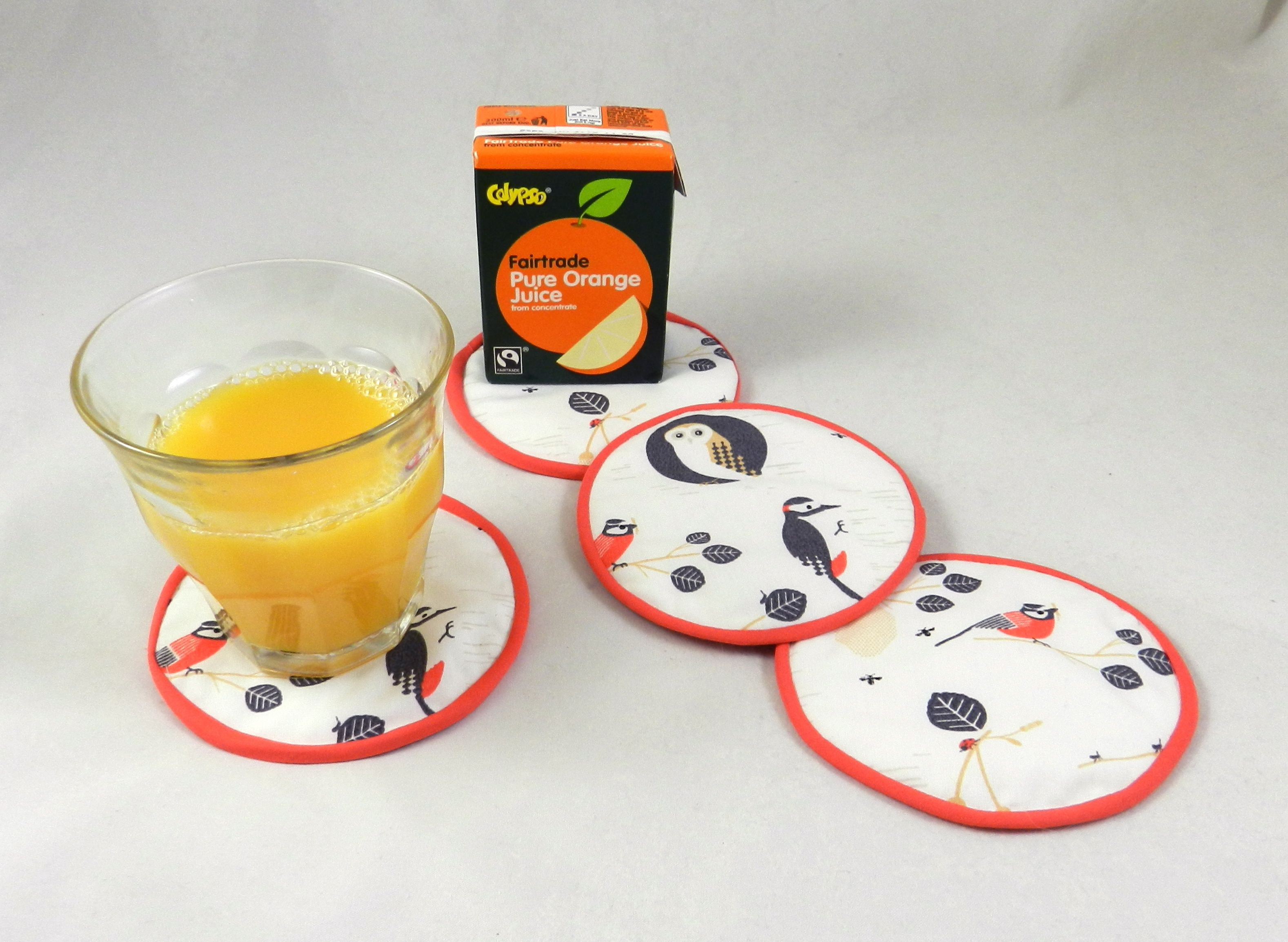 Fairtrade orange juice with coasters made with our In The Trees and Ladybird Red Fairtrade certified cotton fabric #‎fairtradefortnight #‎fairtrade #‎youeattheyeat #cotton