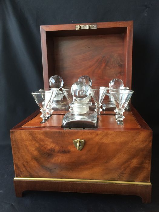 A mahogany liqueur cellar - with three carafes and six glasses - France-second half/late 19th century