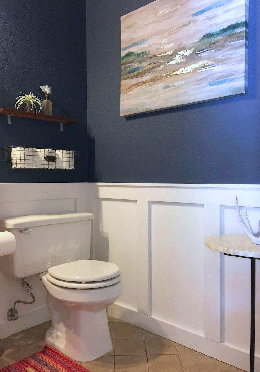 Crisp White Diy Wainscoting And A Striking Deep Blue Wall Color Elevate A Formerly Dull Powder Room Find O White Wainscoting Diy Wainscoting Blue Wall Colors