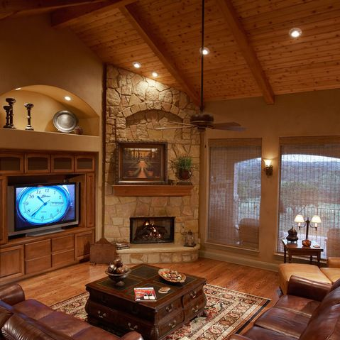 Corner fireplace design ideas pictures remodel and for Cozy living room with fireplace