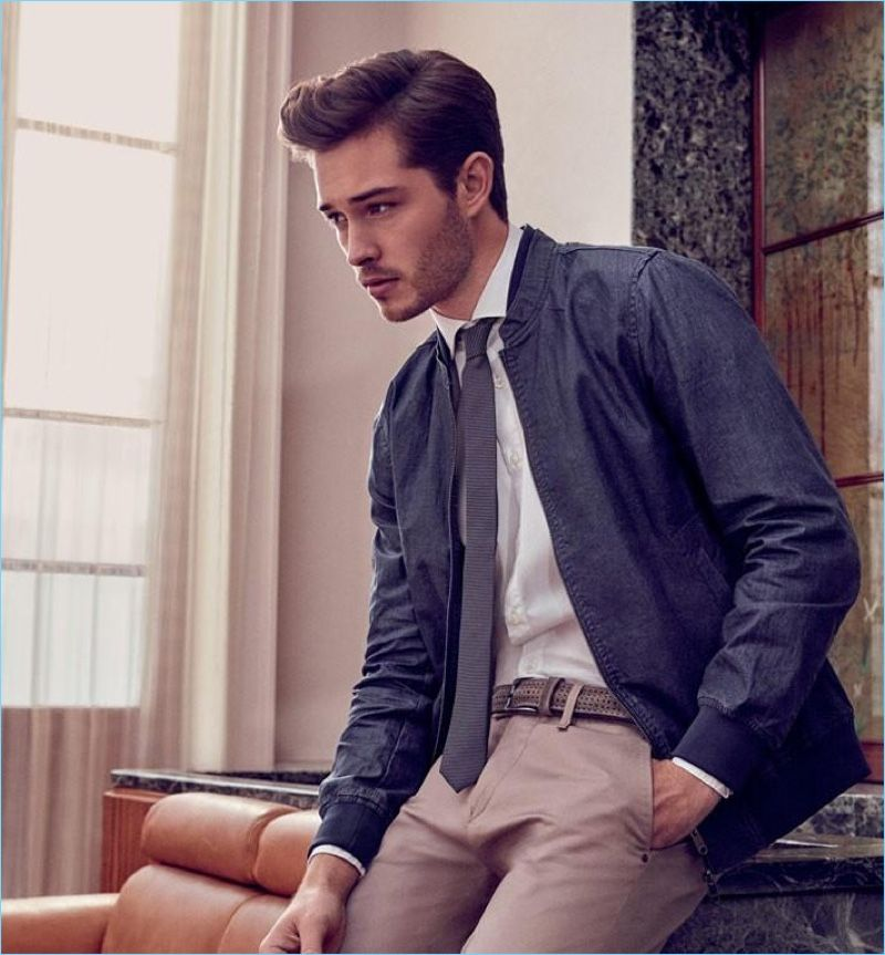 Tapping into a smart aesthetic, Francisco Lachowski wears a bomber jacket with a shirt and tie.