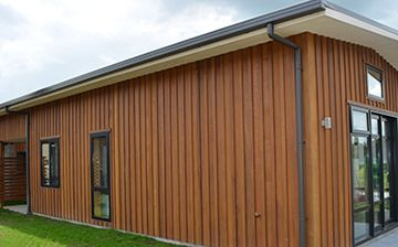 Western Red Cedar Board And Batten Cladding Systems With Wide Vertical Timber Boards Battens Covering The Joins Offer Superior Weather Tightness
