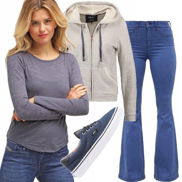 Look casual e comodo caratterizzato da t-shirt a manica lunga abbinata a dei jeans a zampa, sneakers basse e felpa con zip per le sere in cui fa freschino e un outfit salva serata è necessario.