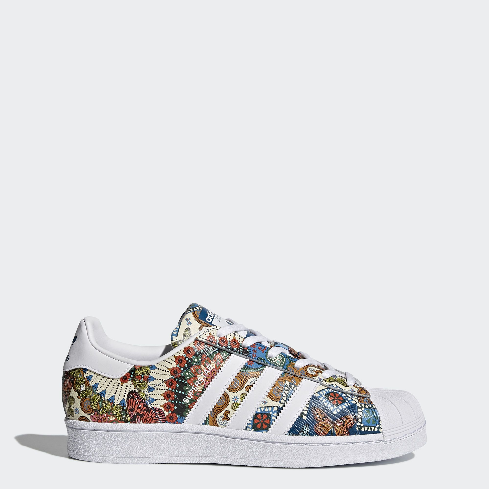 e6e2cba911 The adidas Superstar shoe travels to the tropics. These women's shoes get  revamped with a print designed with Brazil's The FARM Company.