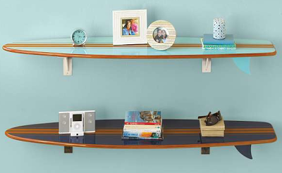 Schon Two Surfboard Wall Shelves With Items On Them