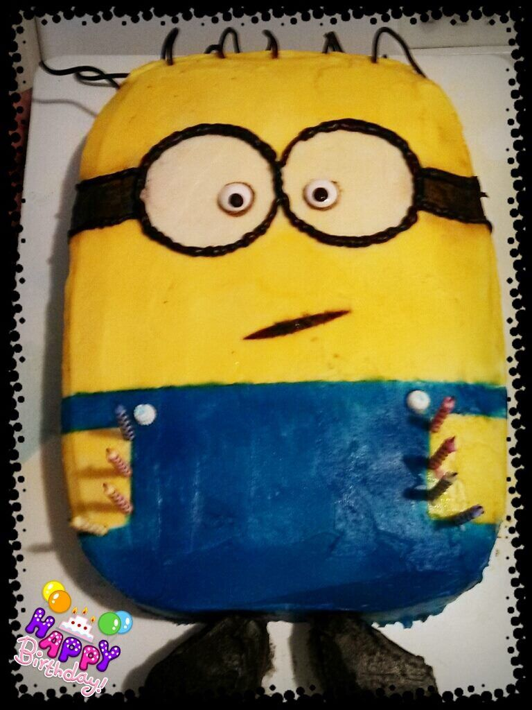 Homemade minion cake with buttercream frosting and spray coloring