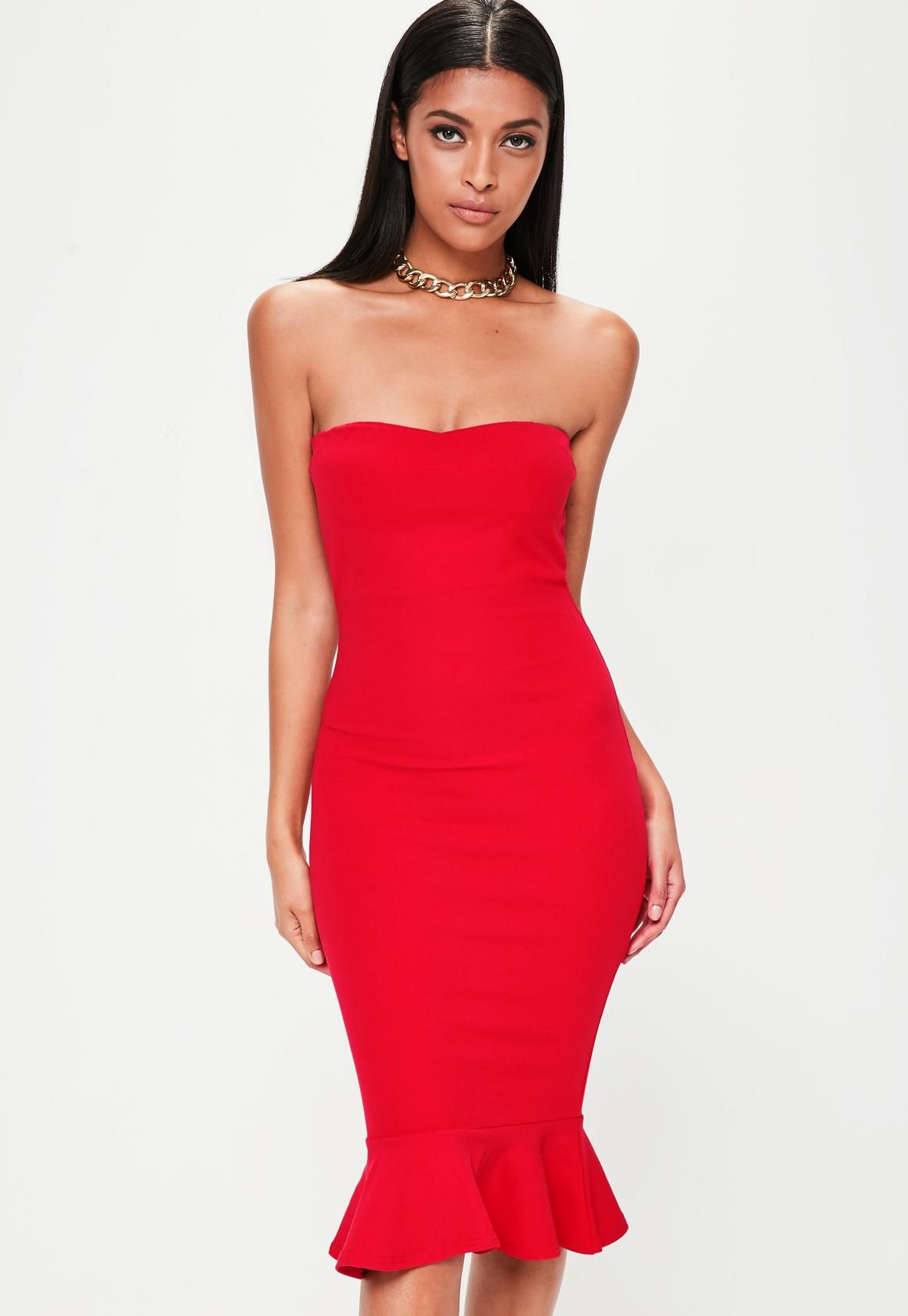 Red dress featuring a frilled hem line bandeau neckline and bodycon