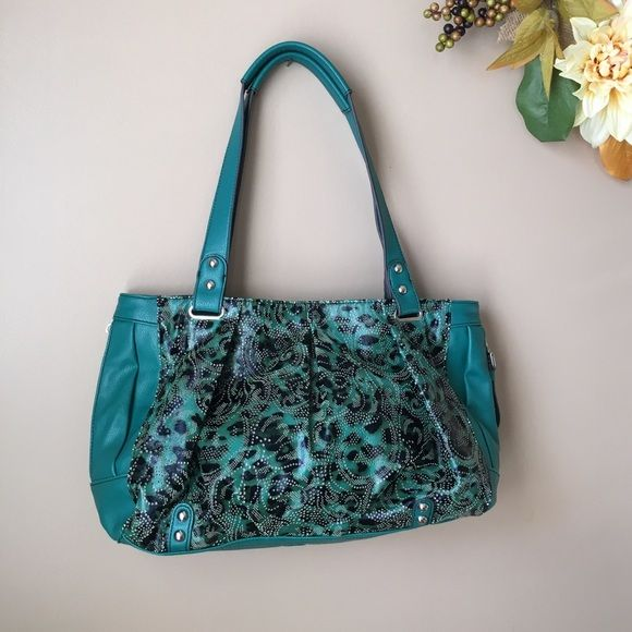Kathy Van Zeeland Handbag Emerald green with a beautiful cut out paisley design on the front side. Lots of side and interior compartments.. I carried it a few times. Kathy Van Zeeland Bags Satchels