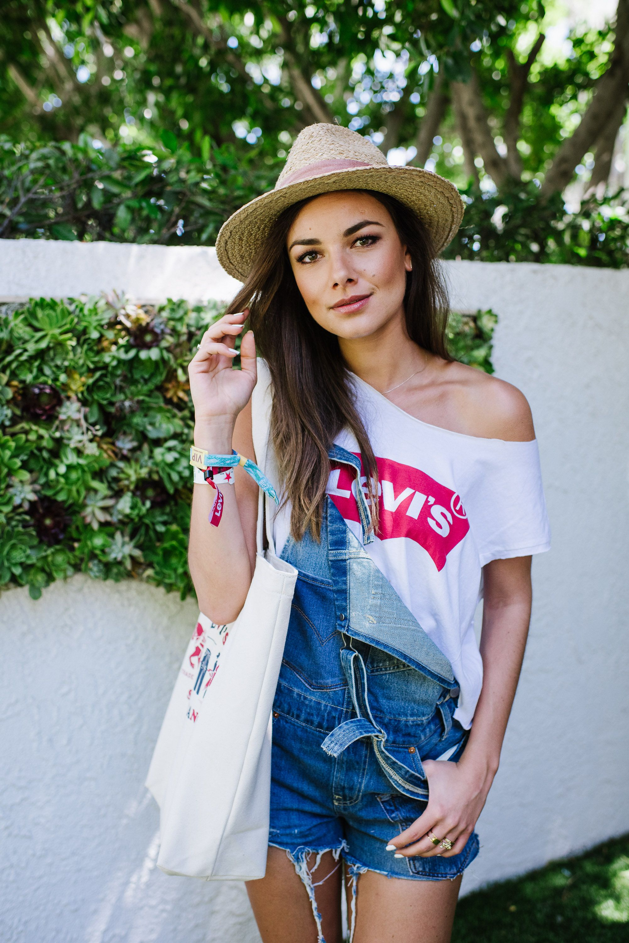 e615d66f5851 Janina Uhse pairs her Levi s graphic t-shirt with easy denim overalls and a  straw hat to top it off.  LadiesInLevis