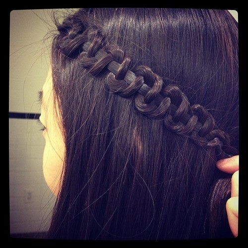 a slide braid! braid normal but loosely. then hold one strand and push up other two.