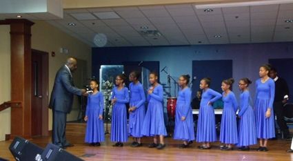 The Rev. Robert Campbell asks the young members of one of New Beginning Christian Church introduce themselves to the congregation at a recent service.