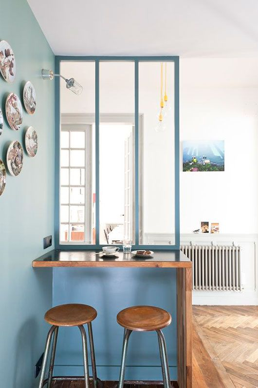 teal and blue walls with buit-in table in stylish paris penthouse / sfgirlbybay