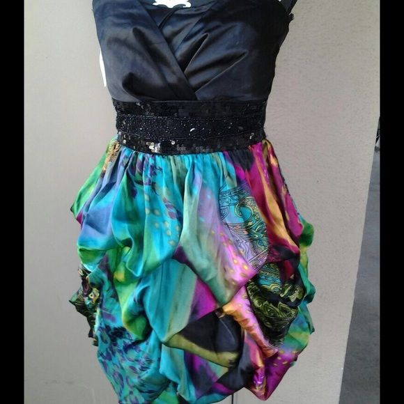 Strapless bubble dress Juniors dress. Sequin waist. Multi color dress. No trades, no lowball offers. Measurements available upon request. Speechless Dresses Prom