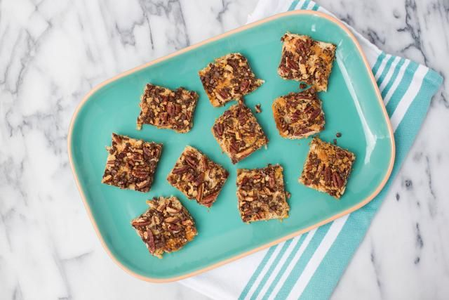 These magic cookie bars are a family favorite. Always a hit, these cookies are made with layers of coconut, graham cracker, chocolate, and pecans.