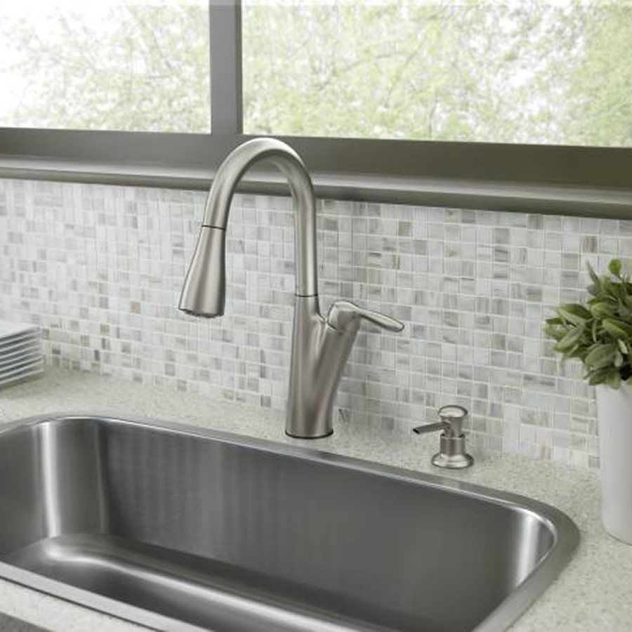 This stainless steel kitchen faucet resists fingerprints and water ...