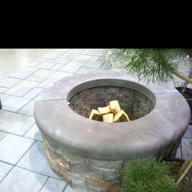 Rinox fire pit on Nicolock paver patio.