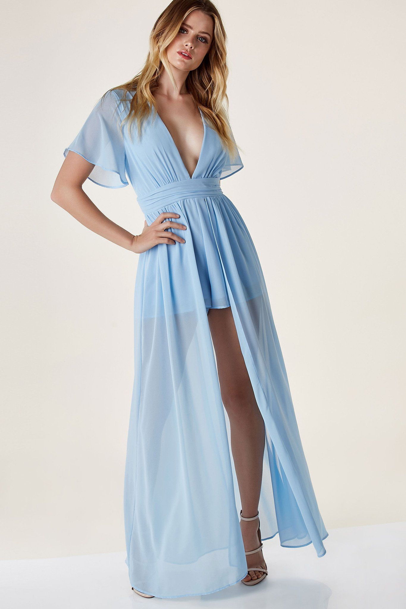 0ea22fdd7c0 Lightweight chiffon romper with deep V-neckline and flared short sleeves.  Flowy maxi overlay with cut out back and button zip closure.