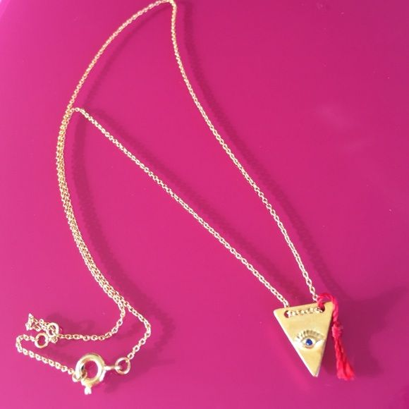 """Gold Triangle Evil Eye Necklace With Red Tassel Ward off bad vibes and boring style in this Gold Triangle Evil Eye Necklace With Red Tassel!  Approx. Charms size: Triangle 1/2""""x 1/2""""x 1/2""""   Approx. Chain length: 15.5"""" and 2"""" extension  Material: Gold plated brass IBestest Jewelry Necklaces"""