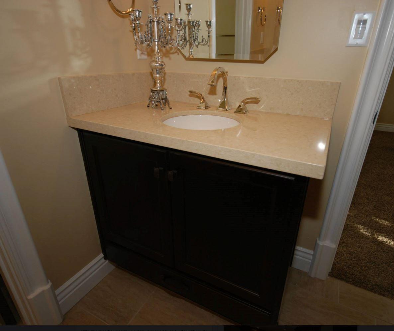 Jack jill bathroom starmark cherry cabinets with java for Bathroom cabinets yorkshire
