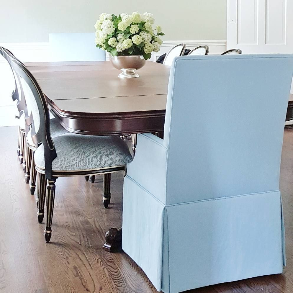 blue upholstered host chairs and wood frame side chairs   Dining ...