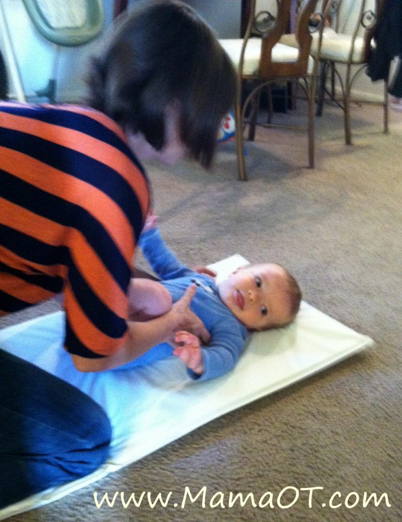 how to teach baby to roll back over