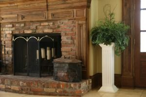 Our square fluted pedestals make the perfect corner plant accent.