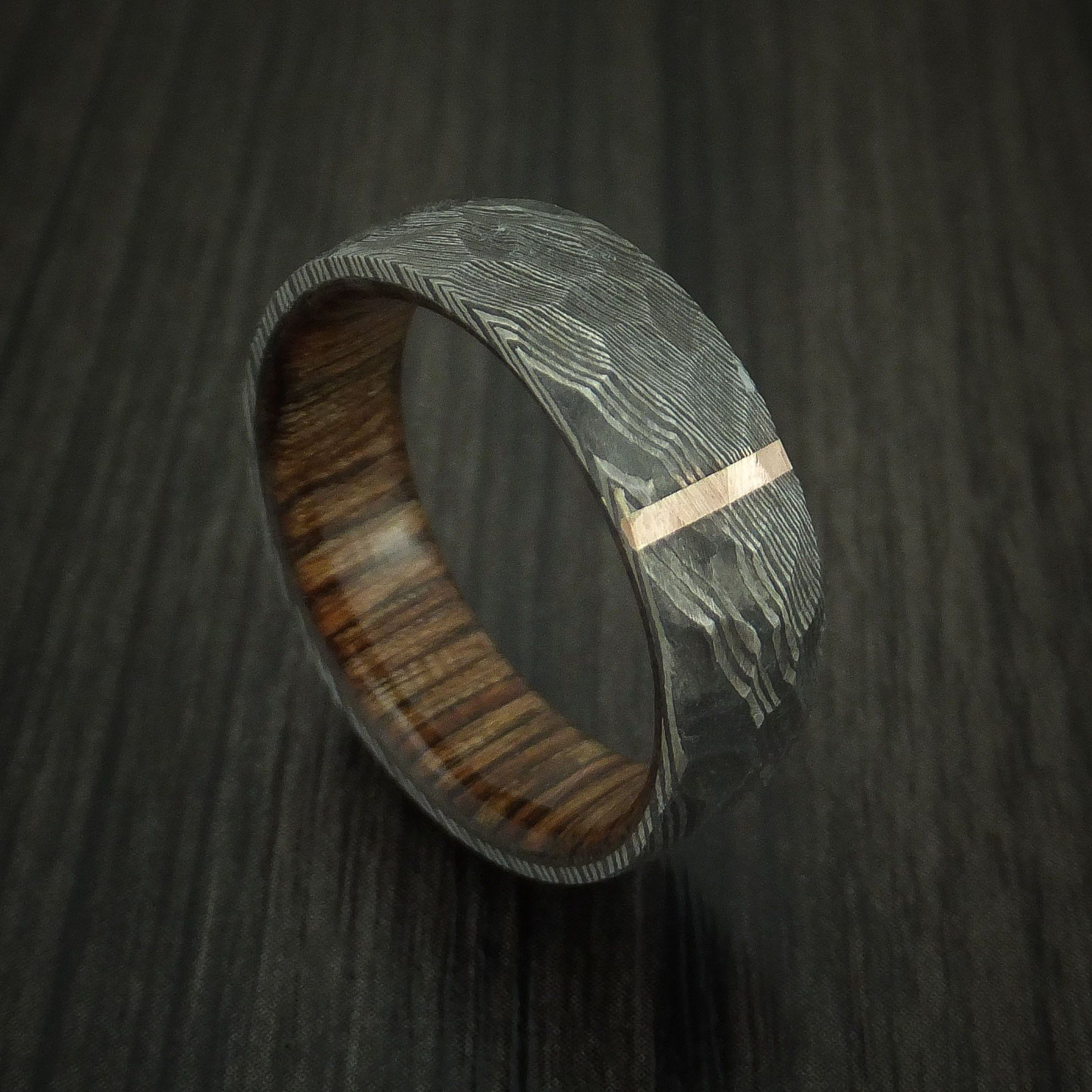 Damascus Steel Ring with Rock Hammer Finish and Vertical 14k Rose Gold Inlay and Wood Sleeve Custom Made Band