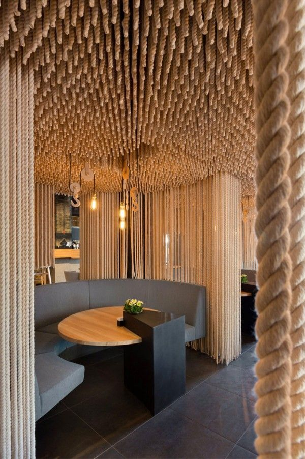 Divider concept with rope hanging from ceiling to floor for Interior decoration pictures of restaurant