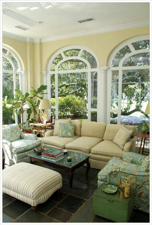 This is a beautiful sun room. Yellow is quite a difficult colour to work with, in this space the softness of the yellow wall colour and the very pale yellow chesterfield work well together without over powering the space. Hints of yellow in the beautiful chair fabric unite everything. Very nicely done.