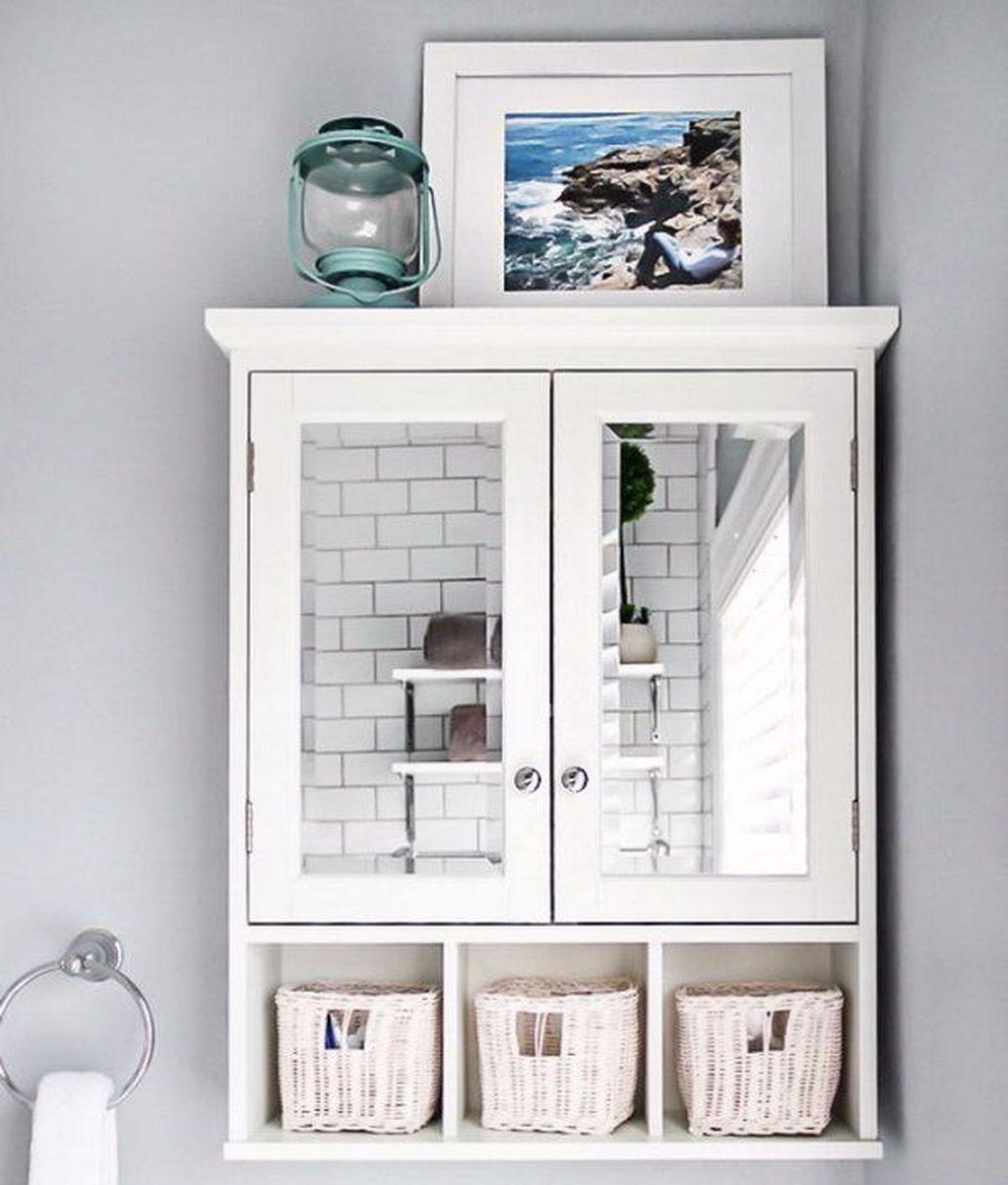 30 Simply Small Bathroom Storage Ideas In 2020 Small Bathroom Small Bathroom Storage Cabinet Above Toilet
